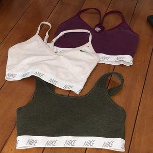 Three Nike sports bras. Size M